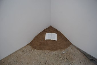 Book and sand
